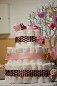 Cakes made of diapers on white — ストック写真