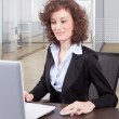 Businesswoman in office — Stock Photo #35763701