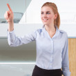 Young beautiful businesswoman pointing at copyspace — Stock Photo