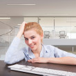Business woman sitting at her desk — Stock Photo
