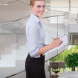 Woman take note in office — Stock Photo