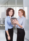 Two woman using tablet — Stock Photo