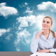 Businesswoman with head in the cloud — Stock Photo