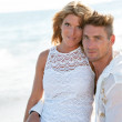 Attractive couple close up on beach. — Stock Photo #12792317