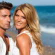 Close up portrait of handsome couple on beach. — Stock Photo