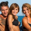 Close up portrait of young group on beach. — Stock Photo