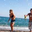 Dancing under champagne bubbles on beach. — Stock Photo #12792473