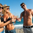 Tree attractive friends making a toast on the beach. — Stockfoto