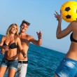 Young group of friends having fun with ball game. — Stock Photo