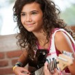 Cute girl playing the guitar. — Stock Photo