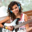 Cute girl at guitar practice. — Stock Photo #13137532