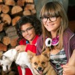 Stock Photo: Cute teenage girls with their dogs.