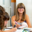 Portrait of young girl at homework desk. — Stock Photo
