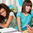 Teenagers discussing their homework. — Stock Photo