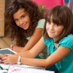 Teenagers doing homework at home. — Stock Photo