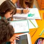 Three girls busy with homework. — Stock Photo