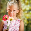 Cute girl holding flowers. — Stock Photo