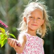Cute girl picking wild berries. - Stockfoto