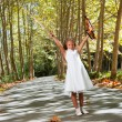 Full length portrait of young violinist in woods. - Stock Photo