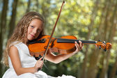 Close up Portrait of young violinist in woods. — Stock Photo