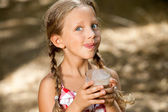 Expressive girl drinking milkshake. — Stock Photo