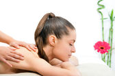 Young woman having back massage. — Stock Photo