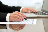 Close up of female hands doing paperwork. — Stock Photo