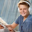 Close up portrait of teen boy with tablet. — Stock Photo