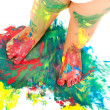Babies feet on colorful mosaic paint. — Stock Photo