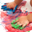 Stock Photo: Babies hands painting colorful mosaic.