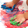 Babies hands painting colorful mosaic. — Stock Photo