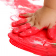 Infant hand painting red mosaic. — Stock Photo