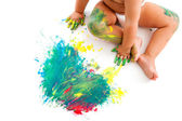 Baby sitting neat to painted mosaic. — Stock Photo