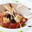 Cod fish and sweet red pepper dish. - Stock Photo