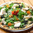 Black olive and rucola pizza with fresh mozzarella. - ストック写真