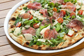 Close up of Italian smoked ham pizza. — Stock Photo