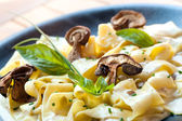 Close up of taggliatelle with funghi porcini. — Stock Photo