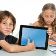 Cute boy student pointing on blank tablet screen. — Stock Photo #14180255