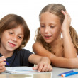 Stock Photo: Children doing homework together.
