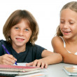 Boy and girl at homework desk. — Foto Stock