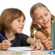 Stock Photo: Cute girl showing classmate homework on tablet.
