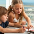 Girl helping boy with homework. — Stock Photo #14180352