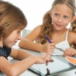 Two kids doing homework on digital tablet. — Stock Photo