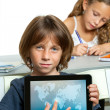 Young boy student showing world map on tablet. — Stock Photo