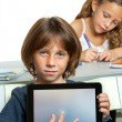 Young boy student pointing on blank tablet screen. — Stock Photo