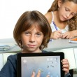 Young boy student showing homework on digital tablet. — Foto de Stock