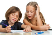 Children doing homework together. — Stok fotoğraf