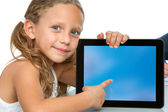 Close up of cute girl pointing on blank tablet screen. — Stock Photo