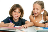 Boy and girl at homework desk. — Stock Photo