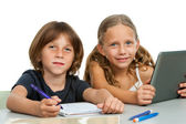 Portrait of two young students at desk. — Stock Photo